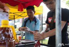 Photo of Neslyšící prodejci hamburgerů vMalajsii
